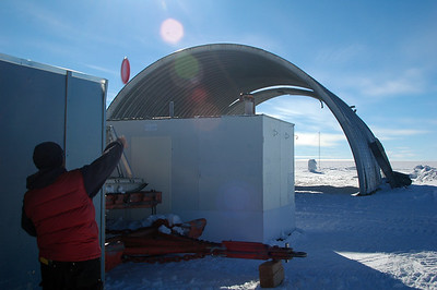 SOUTH POLE STATION, ANTARCTICA: More obstacles... Chuck chucks a hammer over a small hut into the arch where the goal is.