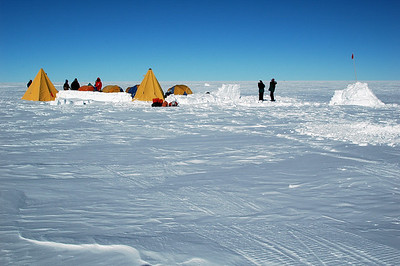 SOUTH POLE, ANTARCTICA: Finally we arrive and camp is all a buzz with the folks who rode out on the Piston Bully snow vehicle. Some are setting up camp and others checking out the vast view.