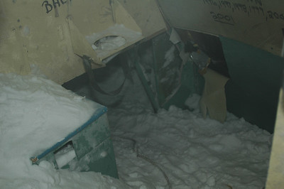 SOUTH POLE, ANTARCTICA: The passageway down to the cargo bay is almost completely filled with snow, but there's just enough room to squeeze in.