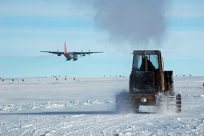 SOUTH POLE STATION, ANTARCTICA: A forklift drives by as the plane continues to rise and will circle back around to return to McMurdo Station on the Antarctic coast.