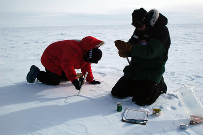 SOUTH POLE STATION, ANTARCTICA: Randi measures the angle while Kris gets ready to add an extention to the pole.