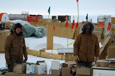 SOUTH POLE STATION, ANTARCTICA: Electricians Dainella and Steve rummage around the outdoor storage area for more parts.