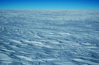 SOUTH POLE, ANTARCTICA: Looking ahead, we still have a ways to go. Camp is established and is just a small bump on the horizon.