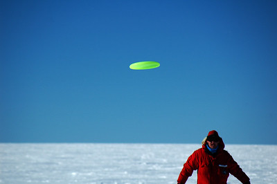 SOUTH POLE, ANTARCTICA: Chris launches the flying disc.