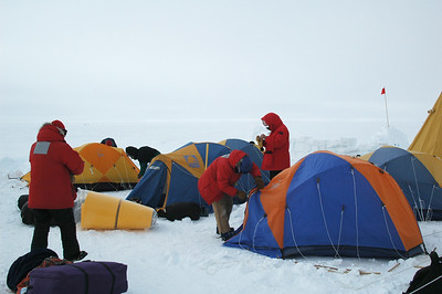 SOUTH POLE, ANTARCTICA: The clouds moved in over night and we were greeted by a windy gray sky the next morning. Everybody starts taking the tents down to strike camp.