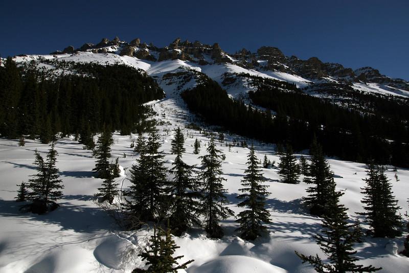 Skiing alongside the west face of Dolomite Peak