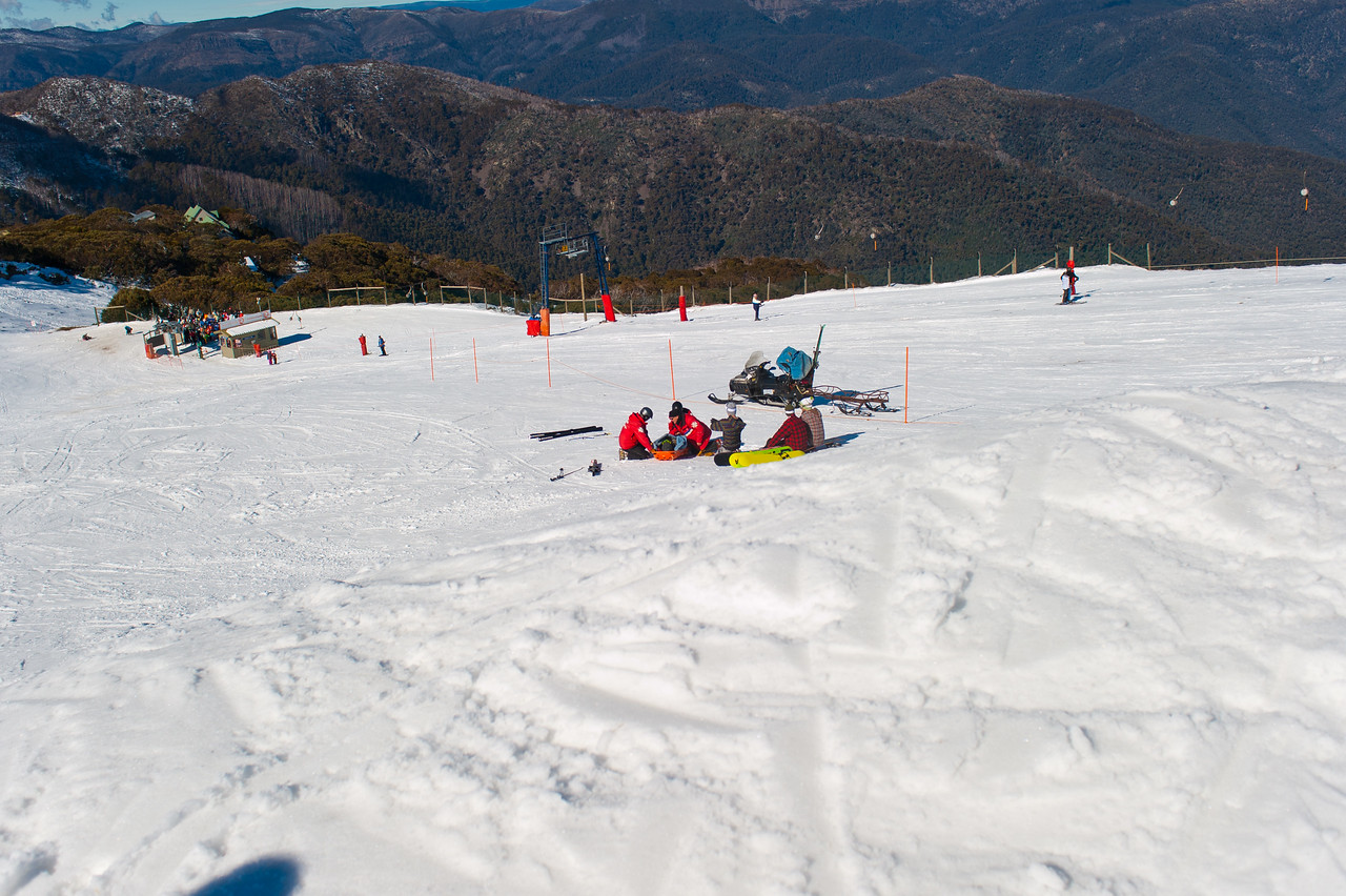 Ski patrol attending injured rider (bad landing on the knuckle)