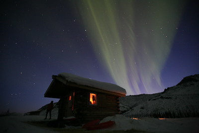 WHITE MOUNTAINS, AK - An awesome display of the Aurora Borealis right over Caribou Bluff Cabin on our 10-day, 100-mile hut to hut ski trip in the Alaskan Interior. Can you spot Orion's Belt?