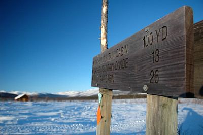 WHITE MOUNTAINS, ALASKA. Cashe Mountain Cabin sign