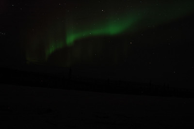 WHITE MOUNTAINS, ALASKA. A faint ribbon of Northern Lights (Auora Borialas) seen from Moose Creek Cabin.