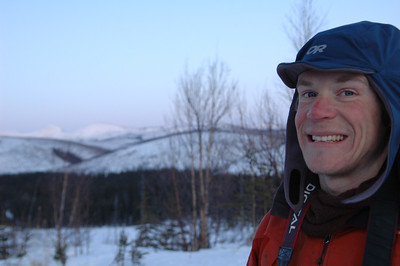 WHITE MOUNTAINS, ALASKA. Nathaniel Wilder at Caribu Bluff Cabin.