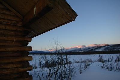 WHITE MOUNTAINS, ALASKA. Cashe Mountain Cabin Sunset