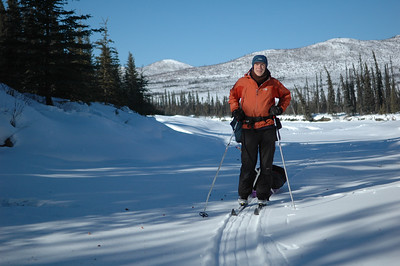 WHITE MOUNTAINS, ALASKA. Nathaniel skiing into our protected lunch spot on the frozen Bever Creek.