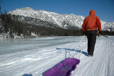 WHITE MOUNTAINS, ALASKA. WIndy Gap Cabin Lake - off to fetch firewood.