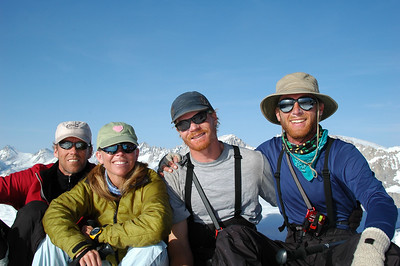 The Atlas Trans-Sierra Team sitting on Copper Mine Pass at 12,300', part of Glacier Ridge jutting north from the Kings-Kaweah Divide in the Sierra-Nevada Mountains. L. to R. Daniel Emerson, Teri Smith, Peter Chapman, Cameron Martindell