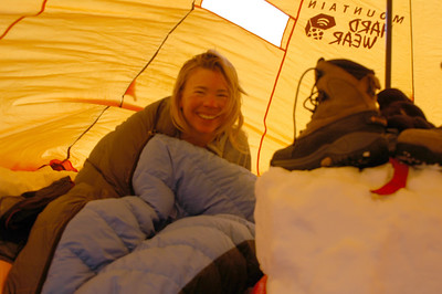 After a cold night, Teri emerges from her sleeping bag with a big smile and is ready to tackle the day.