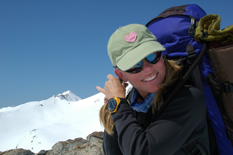 Teri is such a girl... Heart hat, fixing her hair... geez. And with Triple Divide Peak (far left) in the background.
