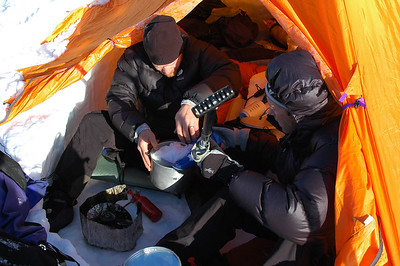 Peter and Daniel melt down some snow to make breakfast with right in the comfort and protection of the kiva.