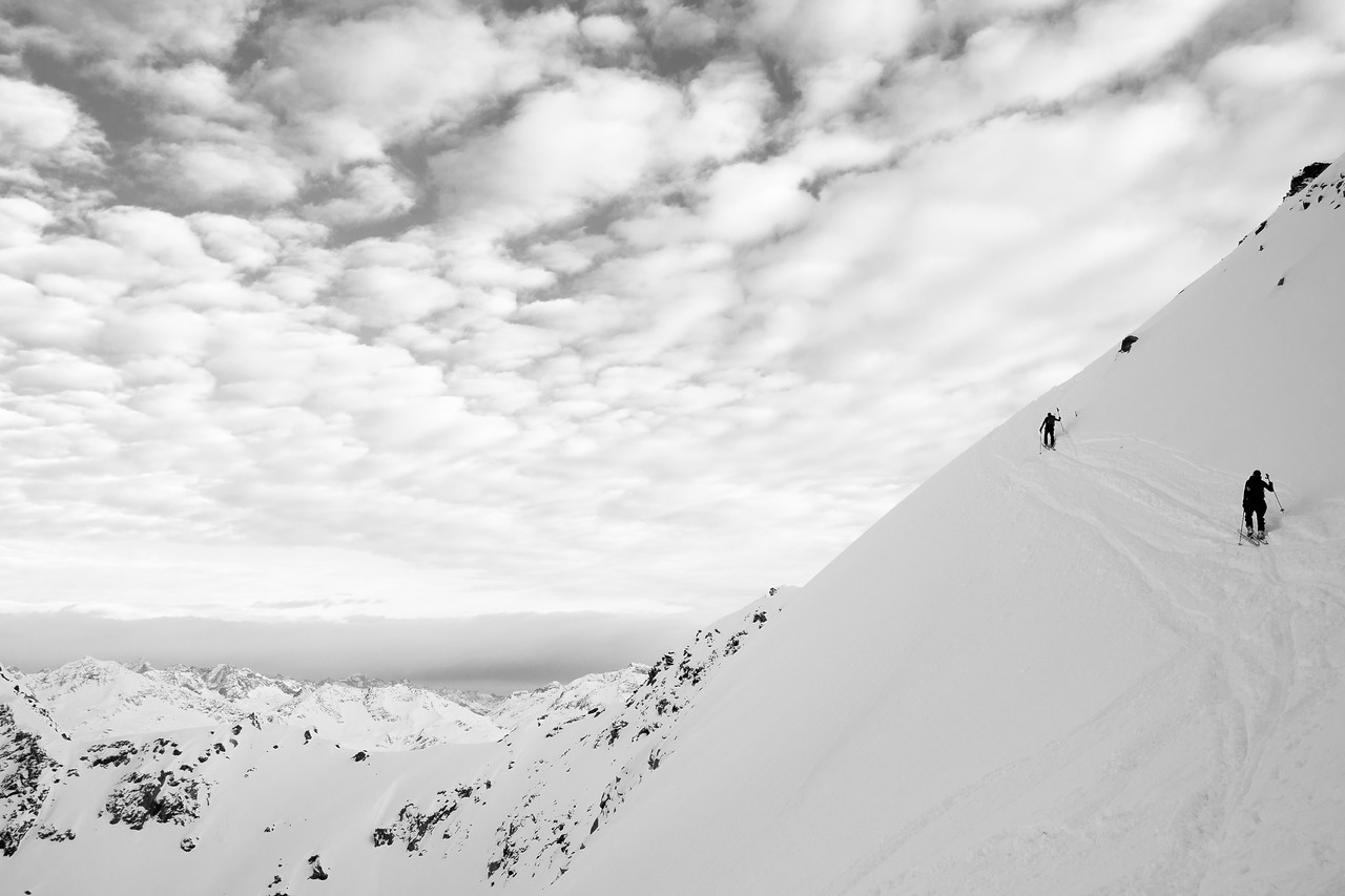 skiers approaching the summit of Cristallina, Ticino, Swiss alps