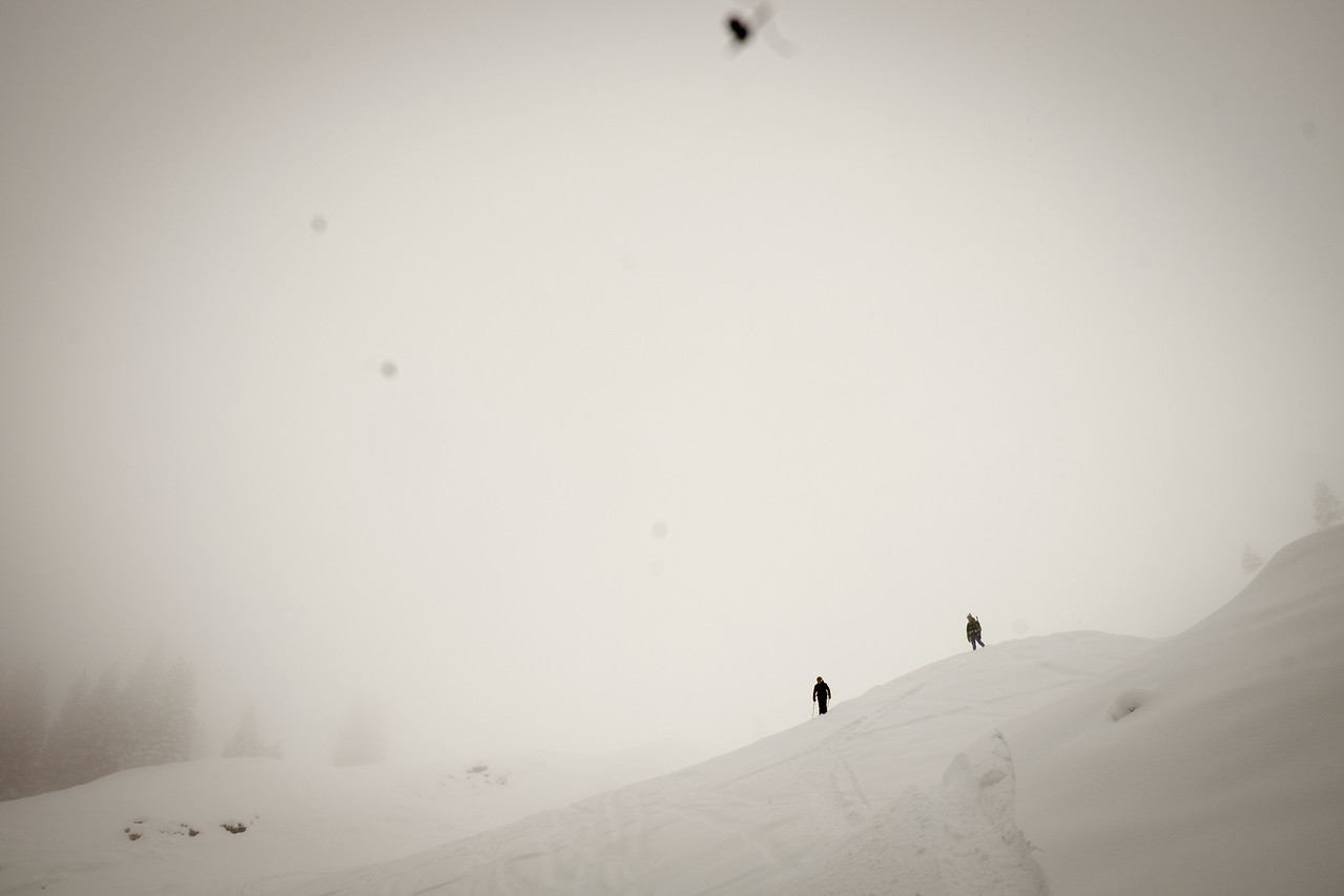 Scouting the descent out of the fog, Redertengrat, Swiss alps