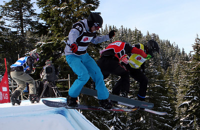 U.S. Snowboarding's Nate Holland (yellow bib) competes in a preliminary heat of the 2009 LG Snowboard FIS World Cup at Cypress Mountain, BC. Images in this gallery may be used for editorial use only and photographer must be credited. Photo © FIS – Oliver Kraus