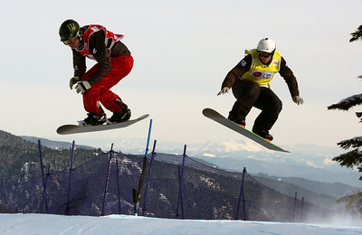 U.S. Snowboarding's Nate Holland (red bib) competes in a preliminary heat of the 2009 LG Snowboard FIS World Cup at Cypress Mountain, BC. Images in this gallery may be used for editorial use only and photographer must be credited. Photo © FIS – Oliver Kraus
