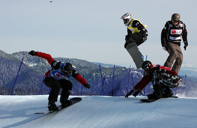 U.S. Snowboarding's Seth Wecott (blue bib) competes in a preliminary heat of the 2009 LG Snowboard FIS World Cup at Cypress Mountain, BC. Images in this gallery may be used for editorial use only and photographer must be credited. Photo © FIS – Oliver Kraus