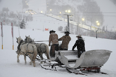 Cowboys drive a horse-drawn sleight through the snow before the superpipe competition in the Sprint U.S. Snowboarding Grand Prix at Park City Mountain Resort in  Utah. (U.S. Snowboarding/Tom Kelly)