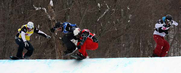 Nick Baumgartner (USA) competes with Jonathan Cheever (USA) in blue, Konstantin Schad (GER) in yellow and Marvin James (SUI) in black in the eighth final 2011 LG Snowboard FIS World Cup Stoneham February 17, 2011 Photo © Oliver Kraus/FIS Image may be used for editorial use only.