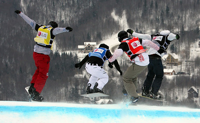 Robert Fagan (CAN) in red competes with Andrey Boldykov (RUS) in blue, Alex Tuttle (USA) in yellow and Omar Visintin (ITA) in the eighth final 2011 LG Snowboard FIS World Cup Stoneham February 17, 2011 Photo © Oliver Kraus/FIS Image may be used for editorial use only.