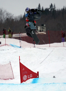Lindsey Jacobellis (USA) leads ahead of Dominique Maltais (CAN) at the final jump of the women's final 2011 LG Snowboard FIS World Cup Stoneham February 17, 2011 Photo © Oliver Kraus/FIS Image may be used for editorial use only.