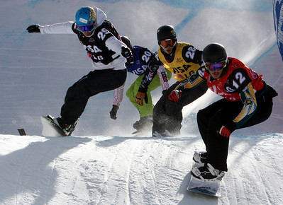 Quarter Final 2 Men: Alex Pullin (AUS, red bib) ahead of Omar Visintin (ITA, black bib), Jonathan Cheever (USA, yellow bib) and Tom Velisek (CAN, blue bib) 2010 LG Snowboard FIS World Cup SBX Telluride Photo © FIS/Oliver Kraus Image may be used for editorial purposes only.