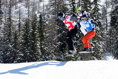 Snowboard Cross Valmalenco, Italy, Eighth Final 4 Men: Markus Schairer (AUT) in red, Robert Minghini (USA) in blue, Nikolay Olyunin (RUS) in black Image may be used for editorial use only. Photo © Oliver Kraus/ FIS