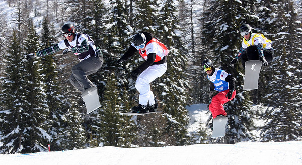 Snowboard Cross Valmalenco, Italy, Eighth Final 5 Men: Alex Deibold (USA) in black, Andrey Boldykov (RUS) in red, Jayson Hale (USA) in blue, Hanno Douschan (AUT) in yellow Image may be used for editorial use only. Photo © Oliver Kraus/ FIS