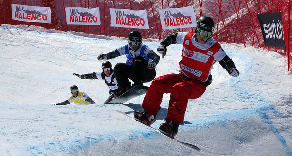 Snowboard Cross Valmalenco, Italy, Quarter Final 3 Men: Nate Holland (USA) in red, Michael Haemmerle (AUT) in blue, Alex Deibold (USA) in black, Hanno Douschan (AUT) in yellow Image may be used for editorial use only. Photo © Oliver Kraus/ FIS