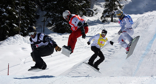Snowboard Cross Valmalenco, Italy, Eighth Final 3 Men: Jonathan Cheever (USA) in black, Nick Baumgartner (USA) in red, Anton Lindfors (FIN) in yellow, Mateusz Ligocki (POL) in blue Image may be used for editorial use only. Photo © Oliver Kraus/ FIS