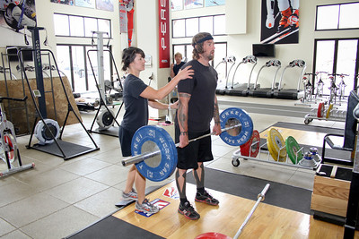 U.S. Snowboarding Physiologist Tschana Breslin assists Shaun Palmer during a work out at the Center of Excellence in Park City, Utah. (USSA/ Marvin Kimble