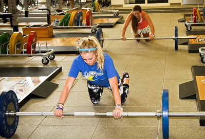 Up front Faye Gulini and Brooke Shaw of the U.S. Snowboarding Team work out at the Center of Excellence in Park City, Utah. (USSA/ Marvin Kimble)