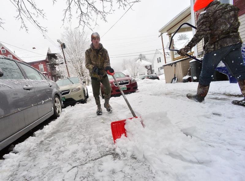 KRISTOPHER RADDER — BRATTLEBORO REFORMER<br /> Harrison Gleim, 16, and Jordan Keefe, 16, of Bellows Falls, work on shoveling Jennifer Joy, of Bellows Falls, driveway on Thursday, Feb. 13, 2020.