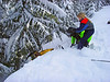 We stopped to help rescue a sled over the edge.  My team is on the end of the rope pulling the sled up onto the trail.
