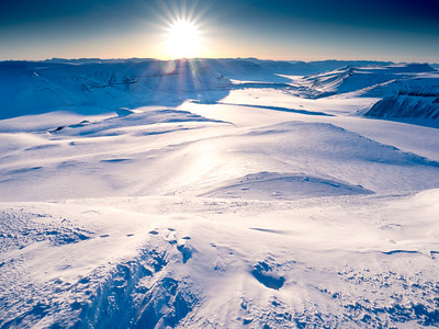 The Arctic in winter is a stark expanse of snow and ice accessable only by snowshoe, ski, or snowmobile unless one simply takes a boat along the coast