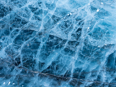 Myriad cracks in the surface of ages old blue glacial ice might have quite a story to tell if they could