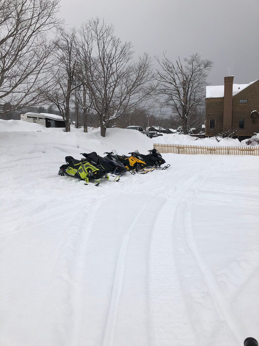 Snowmobiles parked at Mountin Top Inn