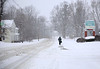 HOLLY PELCZYNSKI - BENNINGTON BANNER Roads in Vermont stay empty while snow continues to fall. Pedestrians brave the cold and some travlers take to walking instead of driving, to stay safe.