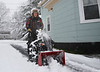 HOLLY PELCZYNSKI - BENNINGTON BANNER Patrick Kinney Jr. snowblows snow from his driveway on Tuesday morning in Bennington.