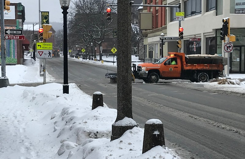 A plow crosses Main Street on to Putnam Street in Fitchburg as snow falls on Sunday afternoon.<br /> SENTINEL & ENTERPRISE / Nick Mallard