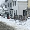 Residents on Salem Street in Fitchburg clear snow from the sidewalk on Sunday afternoon.<br /> SENTINEL & ENTEPRISE / Nick Mallard