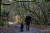 Self portrait with dog, Vancouver, BC<br /> <br /> Like many photographers, I rarely have photos of myself.  Today I had a tripod set up to catch the moss-covered branches on our dog walk, and needed some 'human interest' in the shot.  So I set the camera on the self-timer, grabbed the dog and walked down the path (he is usually off leash, but having him in the right position for this shot required a leash).