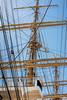 Flying bridge, main mast and sailor climbing ratlines on mizzen mast, Kaiwo Maru, Steveston pier, British Columbia