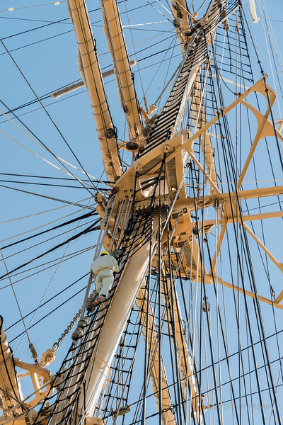 Which line is which; crewman up the mizzen mast ratlines on the Kaiwo Maru, Steveston pier, British Columbia
